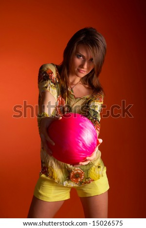 girl holding a  bowling ball