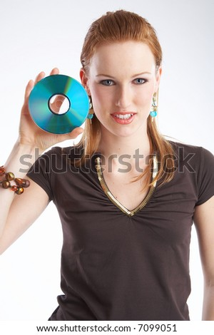 Girl holding a CD next to her hand
