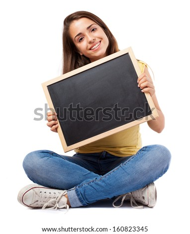 girl holding a chalkboard isolated on white background - stock photo