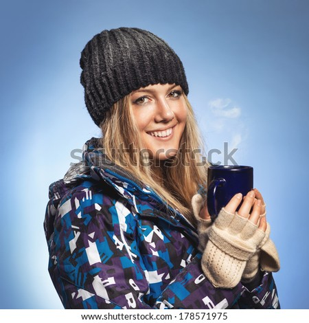 Girl holding a cup and warmed - stock photo