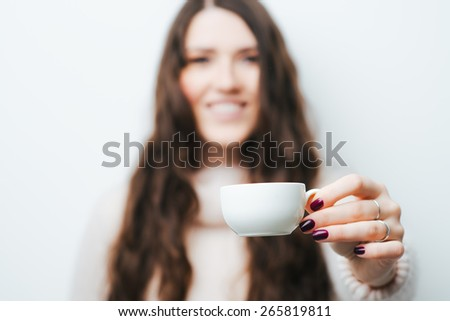 girl holding a cup of coffee - stock photo