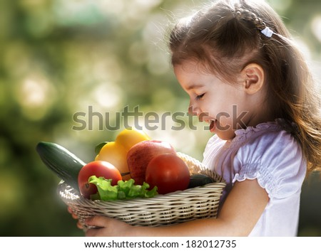 girl holding a fresh vegetables - stock photo