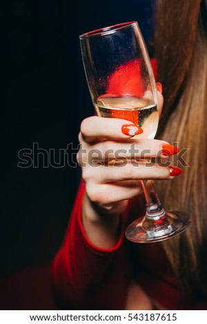 Girl holding a glass of champagne. A glass of champagne. Glass.