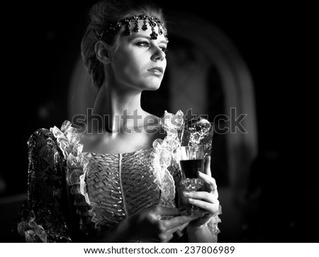 Girl holding a glass of wine vintage style cross processed image - stock photo