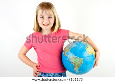 Girl holding a globe under her arm against white background