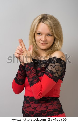 girl holding a hand gun - stock photo