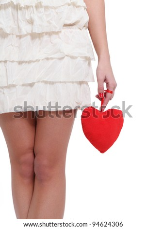 Girl holding a love sign - stock photo