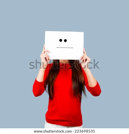 Girl holding a paper with a sad face painted Isolated on White  - stock photo