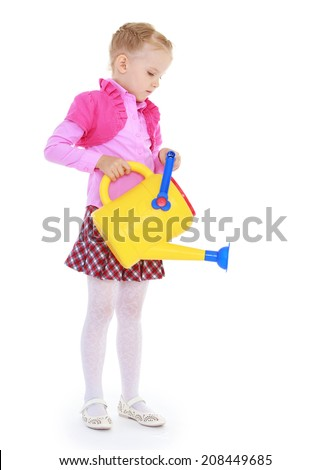 girl holding a plastic garden watering can on a white background.kindergarten, the concept of childhood and joy, teens - stock photo