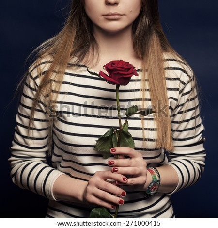 Girl holding a rose - stock photo