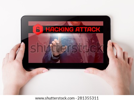 Girl holding a tablet pc which a man presses the virtual screen with text hacking attack. Technology, business, internet, concept. - stock photo