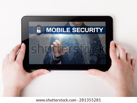 Girl holding a tablet pc which a man presses the virtual screen with text mobile security. Technology, business, internet, concept. - stock photo