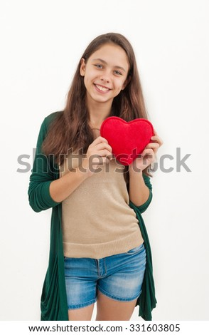 girl holding a toy heart