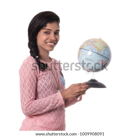 Girl holding a world globe isolated on a white background