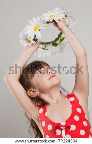 girl holding a wreath over his head - stock photo