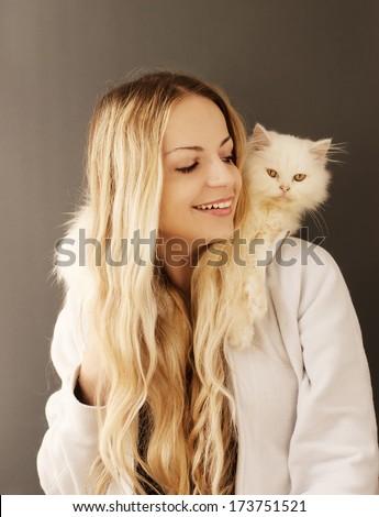 Girl holding adorable Persian kitten  - stock photo