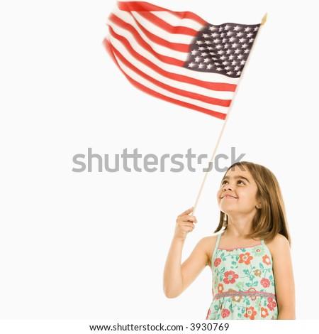 Girl holding American flag against white background. - stock photo