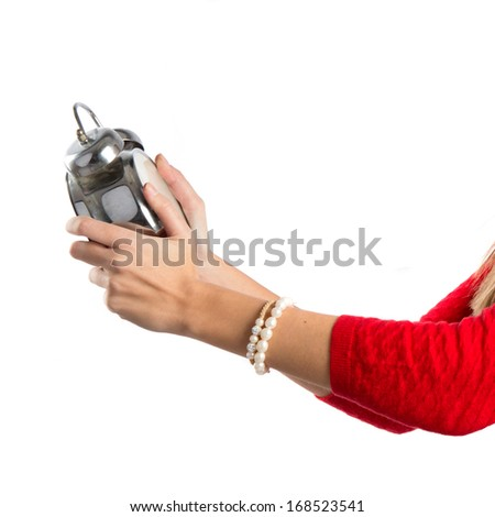 Girl holding an antique clock over white background