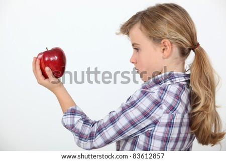 Girl holding an apple - stock photo