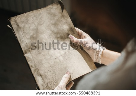 Girl holding an old book in his hands.