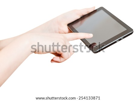 girl holding and touching touchpad screen isolated on white background - stock photo