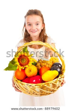 Girl holding basket full of fresh fruit isolated on white - stock photo
