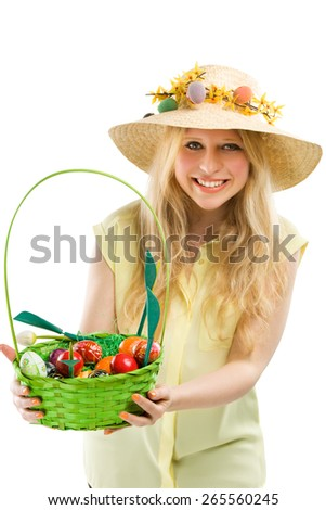 girl holding basket of colored eggs for easter - stock photo