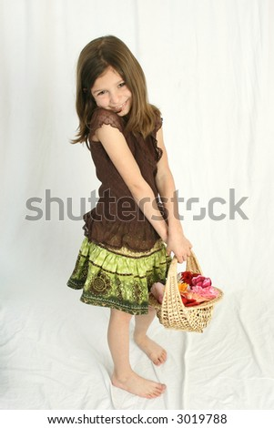 girl holding basket of flowers - stock photo