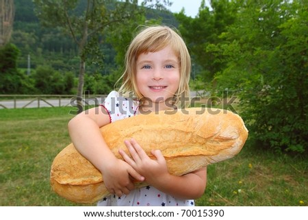 girl holding big bread humor size hungry child funny gesture - stock photo