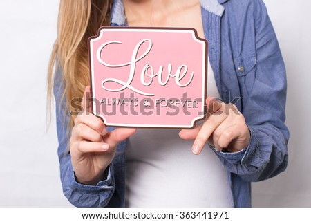 Girl holding board love in hands