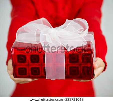 Girl holding Christmas gifts on white - stock photo