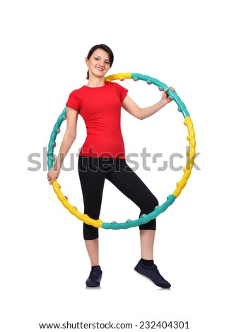 girl holding color hula hoop on white background - stock photo