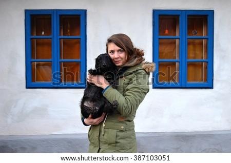 Girl holding dog - stock photo