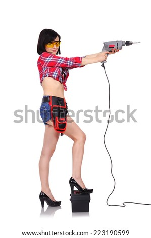 girl holding electric drill on a white background - stock photo