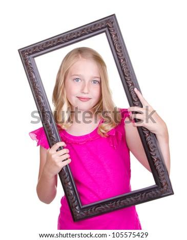 Girl holding frame around face, isolated on white - stock photo