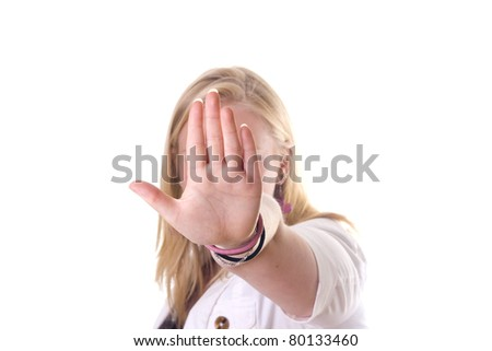 Girl holding hand up saying stop. No face visible - stock photo