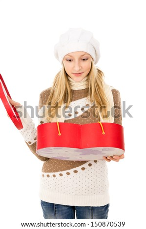 girl holding heart shaped box and wondering - stock photo