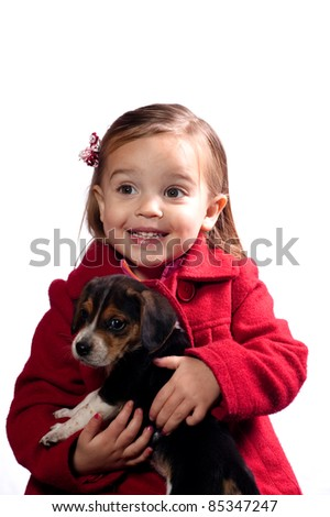 girl holding her puppy - stock photo