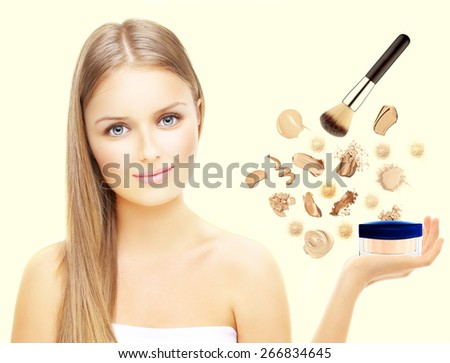 Girl holding in her hand cream foundation.Foundation ,powder and brush isolated over light background - stock photo