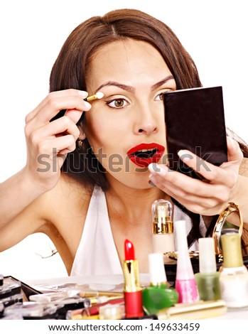 Girl holding makeup brush.  Isolated. - stock photo