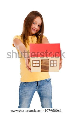 Girl holding model of house isolated on white - stock photo