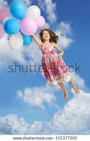 Girl Holding Onto Balloons and Floating In The Air - stock photo