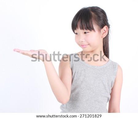Girl holding open palm empty hand emotion isolated on white background - stock photo