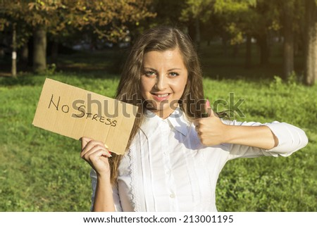 Girl holding paper with inscription no stress. No stress i like concept.