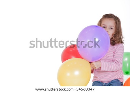Girl holding party balloons with blank space for text. Isolated on white