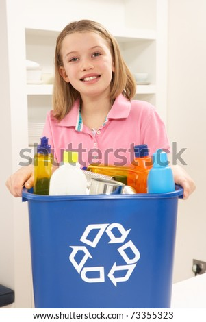 Girl Holding Recyling Waste Bin At Home - stock photo