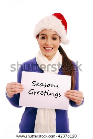 Girl holding 'Seasons Greetings' sign on white background - stock photo