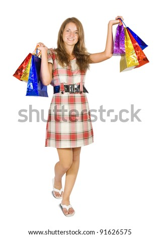 Girl holding shopping bags. Isolated in full length on white background.