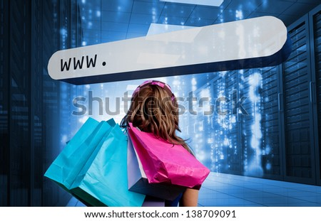 Girl holding shopping bags looking at address bar in data center with matrix - stock photo