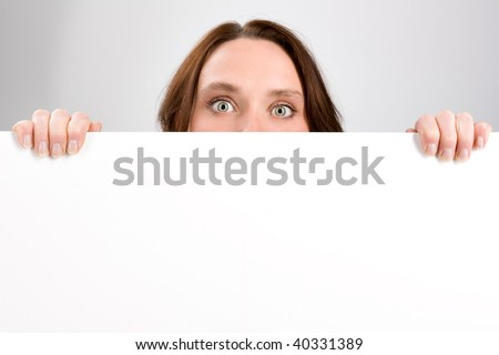 Girl holding sign or board on gray